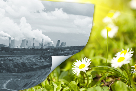 ecological disaster: Smoking chimneys of plants and green grass - symbols of protecting the environment from ecological disaster