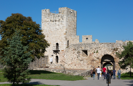 monument historical monument: SERBIA, BELGRADE - OCTOBER 10, 2015: Tourists in the Kalemegdan fortress in Belgrade. Kalemegdan Fortress - the most important historical monument in Belgrade