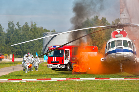 extinguishing: RUSSIA, NOGINSK - AUGUST 7, 2015: Demonstration performances of rescuers of Ministry of Emergency Situations of Russia. Fire extinguishing on aviation equipment.