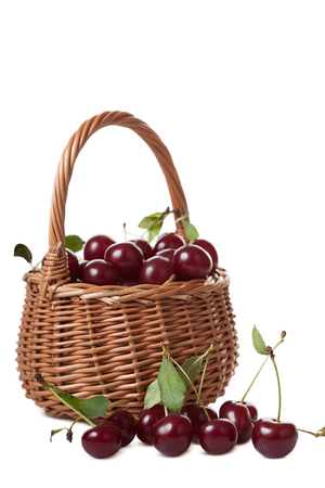 wattled: Wattled basket filled with ripe cherries isolated on white background