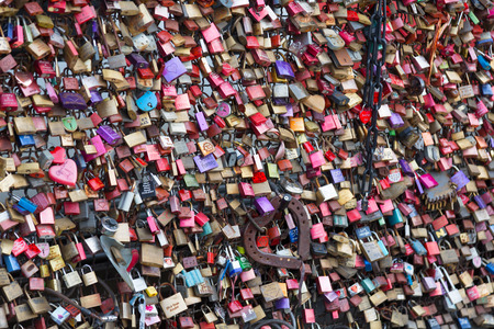 inseparable: COLOGNE, GERMANY - DECEMBER 30, 2015: padlocks of loving couples as a sign of loyalty on the Hohenzollern Bridge in Cologne