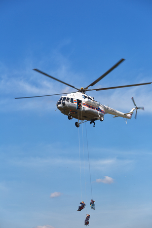 situations: RUSSIA, NOGINSK - AUGUST 7, 2015: The helicopter Mi -BTMVB1 in the sky on doctrines of rescuers of Ministry of Emergency Situations of Russia. Editorial