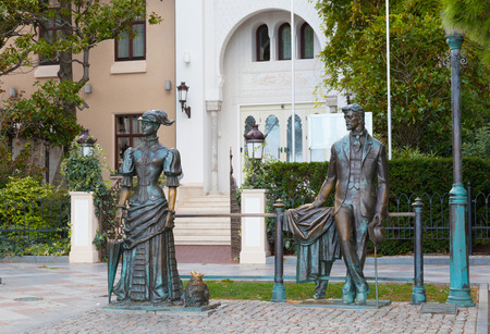 dramatist: RUSSIA, YALTA - SEPTEMBER 24, 2015: Sculpture Anton Chekhov and the Lady with Dog in Yalta, Crimea Editorial