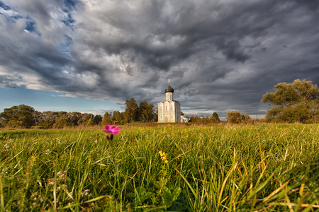 nerl: Reserved meadow near Church of the Intercession of the Holy Virgin on the Nerl River before a rain