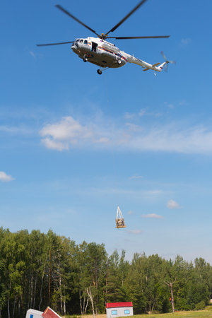 situations: RUSSIA, NOGINSK - AUGUST 7, 2015: The helicopter MI-8 in the sky on doctrines of rescuers of Ministry of Emergency Situations of Russia. Editorial