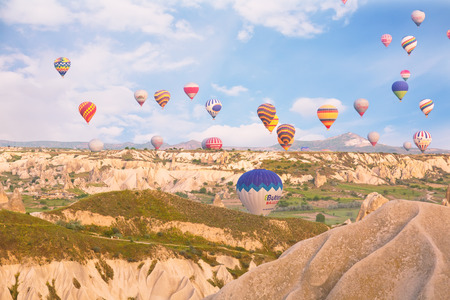 may fly: TURKEY, GOREME - MAY 19, 2015 - Multi-colored balloons fly over rocks.The greatest tourist attraction of Cappadocia , the flight with the balloon