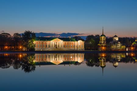 kuskovo: Beautiful Kuskovo Palace reflected in the pond at sunrise, Moscow Editorial