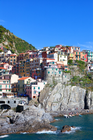 Multi-colored houses in Manarols fishing small village. Laguria, Italy