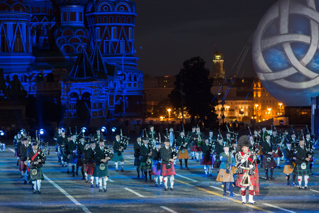 RUSSIA, MOSCOW - AUGUST 26, 2016: A festival of military orchestras Spasskaya Tower at Red Square. Presentation of the consolidated orchestra Celtic bagpipes