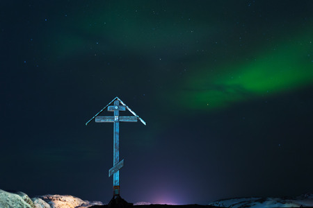 magnetosphere: A large wooden cross on a background of aurora