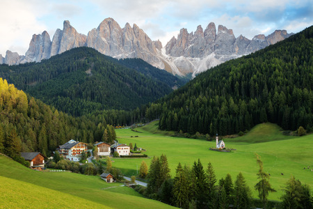 Santa Maddalena village in front of the Geisler or Odle Dolomites Group , Val di Funes, Italy, Europe.
