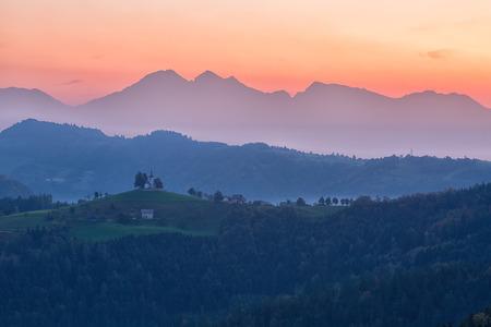karavanke: St. Primoz church in Yamnik at sunrise, Slovenia Stock Photo