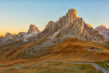 dolomite: Mountain Passo Giau in the Dolomite Alps at sunrise Stock Photo