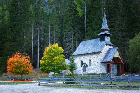 Shapel Marienkapelle at the Braies Lake (Pragser Wildsee) in Dolomites mountains, Sudtirol, Italy Stock Photo
