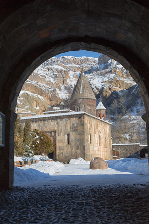 View of the main church of the monastery Geghard through the stone arch, Armenia