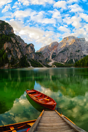 Boats on the Braies Lake ( Pragser Wildsee ) in Dolomites Alps, Sudtirol, Italy