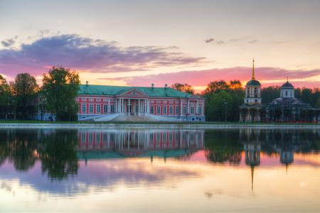kuskovo: Beautiful Kuskovo Palace reflected in the pond at sunrise, Moscow Stock Photo