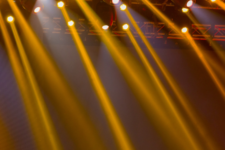 Spotlights illuminate the scene during a concert