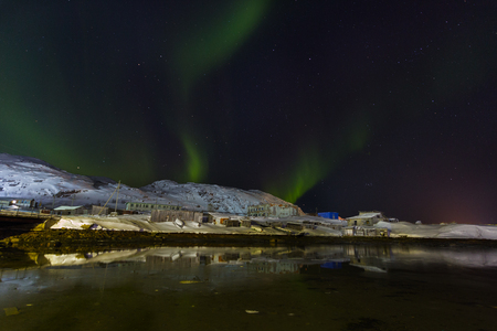 Green Aurora borealis  on Teriberka in Murmansk region, Russia