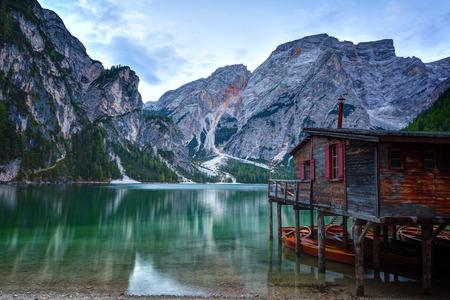 Hut on Braies lake and Dolomiti on sunrise, Trentino Alto Adige, Italy