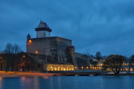 bastion: View of Narva Castle with tall Hermans tower in night. Estonia Editorial