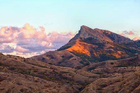 Rocks of the extinct volcano KaraDag at sunset, Crimea