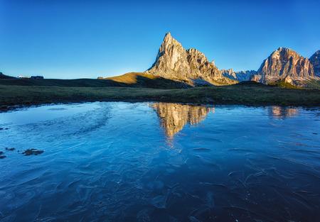 Mount Passo Gyau reflected in the frozen lake, Dolomites, Italy Stock Photo - 88645753