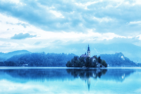 Church on island in Lake Bled n sunrise, Slovenia