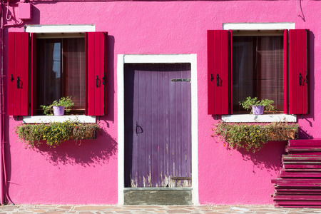 Colourfully painted house facade on Burano island, Italy