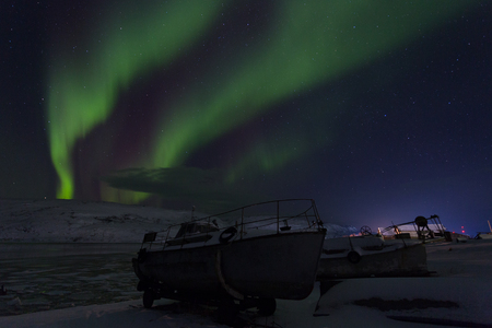 Aurora borealis Green on Teriberka in Murmansk region, Russia