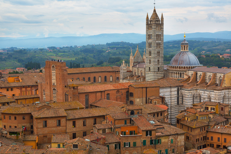 View of Siena Cathedral (Duomo di Siena) and Piazza del Duomo in Siena, Italy