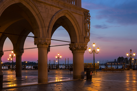 Famous Doge palace, column with winged lion and San Marco square at sunrise in Venice, Italy Editorial