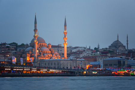 ISTANBUL, TURKEY - MAY 16, 2015: Evening view of one of the mosques of Istanbul and the Galata Bridge Editorial