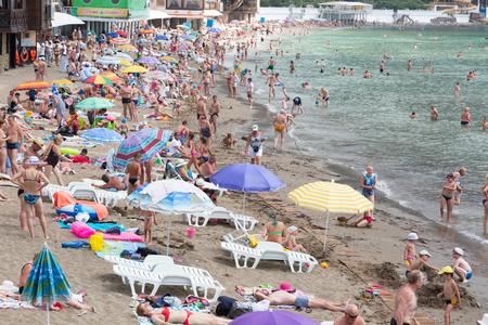 RUSSIA, CRIMEA - JUNE 17, 2015: People are sunning on the beach in the village of Novy Svet on the Black Sea coast