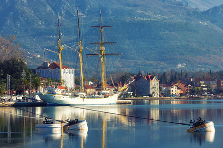 Embankment in Tivat, view of an old sailing ship. Montenegro