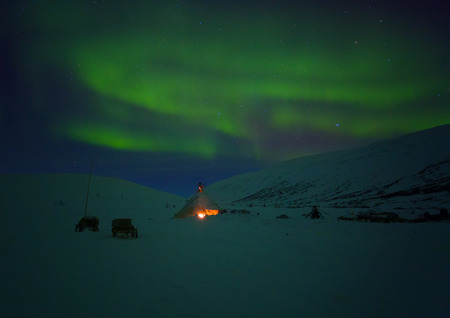Winter night landscape with sledges, tent and aurora in the sky. The Yamal Peninsula. Russia Stock Photo