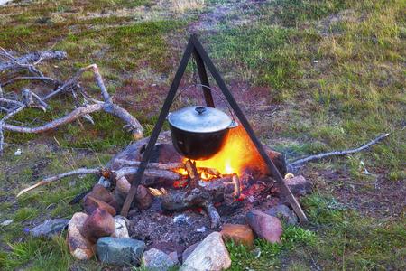 Tourist pot on the fire Stock Photo