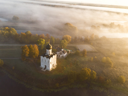 Church of Intercession upon Nerl River. (Bogolubovo, Vladimir region, Golden Ring of Russia) in autumn morning. Aerial photo