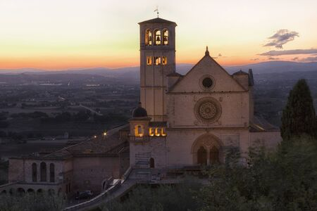Famous Basilica of Saint Francis of Assisi with Lower Plaza in sunset. Assisi, Umbria, Italy