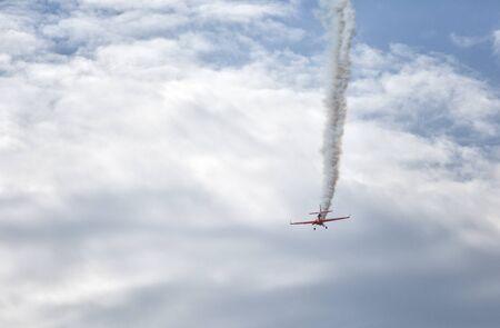 Small red sport plane in the sky Stok Fotoğraf