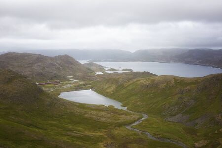 Norway. View of the fjord from the mountain in cloudy weather