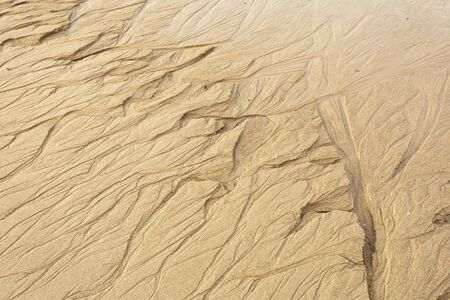 Background for design from sand with traces of water.