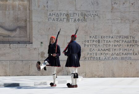 ATHENS, GREECE - FEBRUARY 24 2017: Evzones - presidential ceremonial guards in the Tomb of the Unknown Soldier at the Greek Parliamen, Athens, Greece Editorial