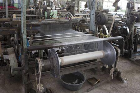 Old loom in a silk factory, close-up. Margilan, Uzbekistan