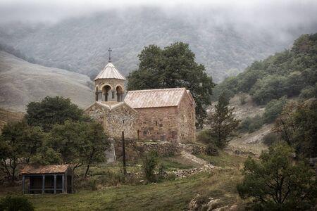 Old church in Armenia in cloudy weather