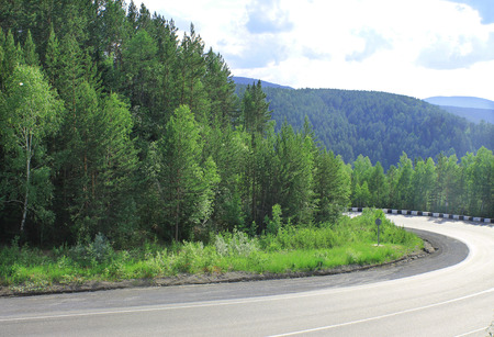 abrupt turn on a mountain pass in the summer time photo