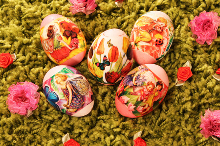 synthetic: Easter eggs with pictures of flowers and butterflies placed on a green synthetic  grass Stock Photo