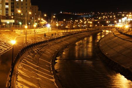 illuminated: River embankment, illuminated by lights at night