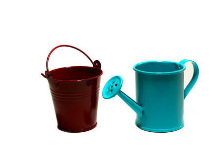 agriculture machinery: Blue garden handshower and a red bucket on a white background Stock Photo