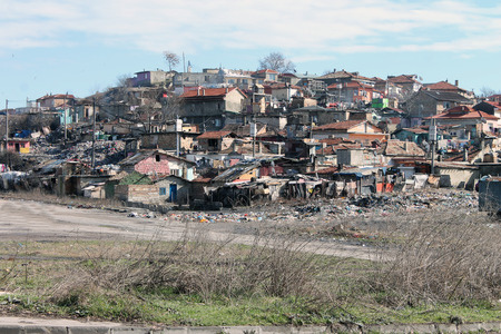 slum: House among the mountains of garbage in a slum area Stock Photo